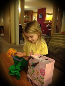 Kyla opening gifts