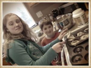 Natalie and Noah making birthday donuts